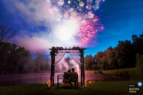 Washington, MO Wedding Reception Photo | Bride and groom enjoy fireworks in their backyard wedding in Missouri.