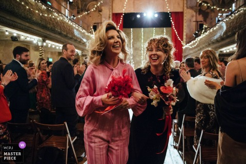 Wiltons Music Hall, London, UK Wedding | Two brides at the end of their ceremony