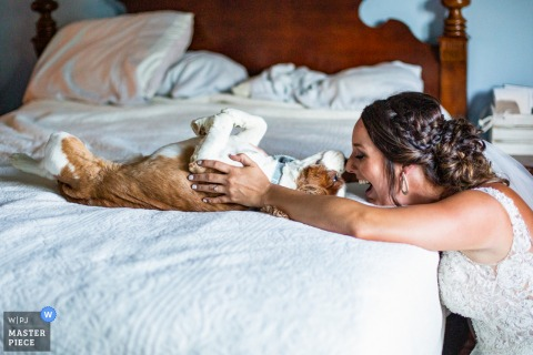 Nashville Tennessee Wedding Photography | The bride spends a moment with her first love before the ceremony. Knox the spaniel was happy to see her but not inspired enough to get up from his nap.