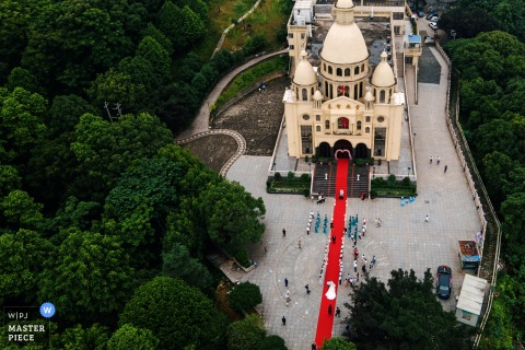 Zhejiang Wedding Ceremony Image | Arial shot of the church - because of the covid-19, everyone was forced to hold a wedding outside the church.