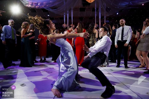 Guests dance during a wedding reception at Seawell Ballroom