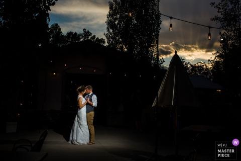 Colorado Restaurant Patio Wedding Image | Bride and groom dance on the patio of the restaurant