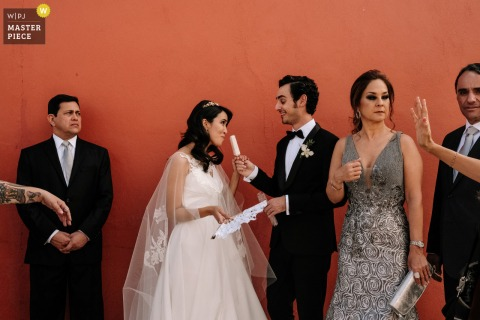 Oaxaca City Wedding Image | bride and groom cooling down with a popsicle