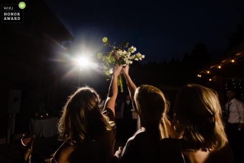 Philipsburg, Montana bouquet toss wedding photography shot at night