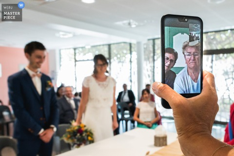 Agen, France virtual phone ceremony wedding image of a remote guest viewing the bride and groom