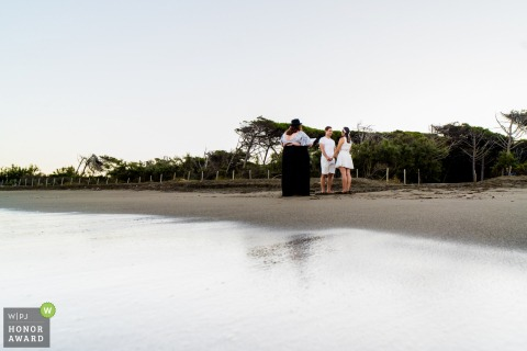 IT wedding photography from the Cecina beach, Italy of a Morning beach ceremony
