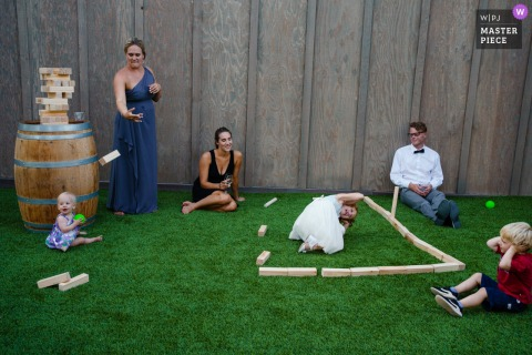 Outdoor wedding photo from Leal Vineyard, California of the grass and lawn Games during cocktail hour