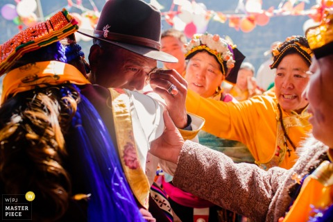 Asia wedding photo from Mountain of San'ao, Heishui County, north of Sichuan Province, China showing The bride's father sends the bride to marry