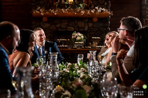 Colorado wedding photography from the Shupe Homestead, Hygiene of the bride and groom laughing during maid of honor speech