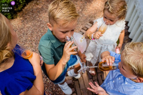 Noord Brabant wedding photography showing a Netherlands Reception that it was so hot and the kids were thirsty