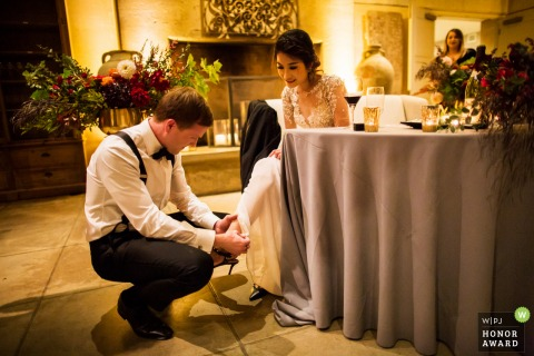 Napa California wedding photography of A bride-grooms tender moment in the other room