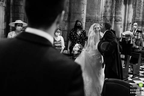 Wedding photography from Eglise Notre Dame la Grande de Poitiers of The bride's father kissing his daughter in the church
