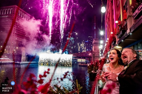 Illinois wedding photography from River Roast, Chicago of the bride and groom with post midnight fireworks
