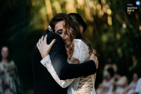 Outdoor, garden wedding photo from São Paulo Brazil Covadonga of an Emotional couple hug