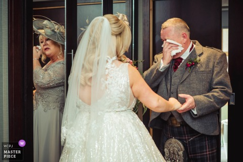 wedding photography from Stirlingshire, Scotland of the Bride's father & mother (reflected in the mirror) crying