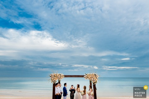 Beach wedding photography of a Vietnam Ceremony showing There is never a better time or place for true love