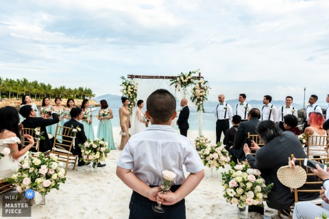 beach wedding photo from the Ho Chi Minh Vietnam outdoor Ceremony Location of The moment they officially becoming a couple must wait a few more minutes