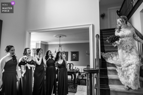 Indoor wedding photo at the bride's parent's home - Detroit, Michigan of the Bride being seen by bridesmaids for first time