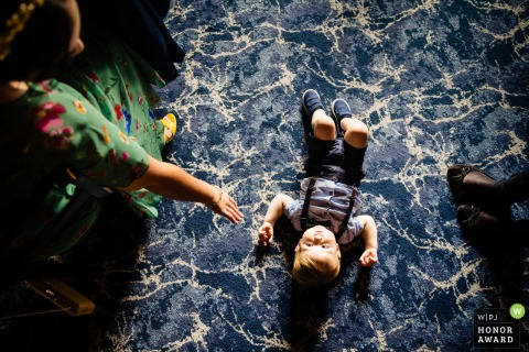 Wedding reportage photography from Brooklodge, Co. Wicklow of a kid playing on carpet