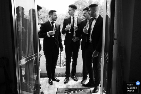 RC wedding photo from Gioiosa Jonica Reggio Calabria, Italy, Groom's home of the Groom toasting with his friends at his home prior Ceremony