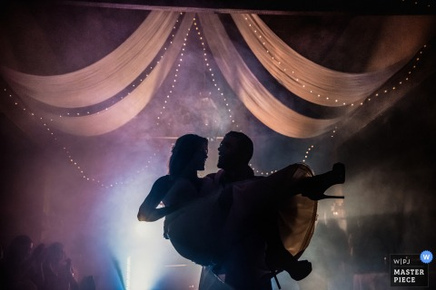 wedding photography from Porto Portugal Reception venue of the First Dance under lights and with dj fog