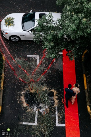 Fujian, China high angle wedding photography showing the red carpet and limo