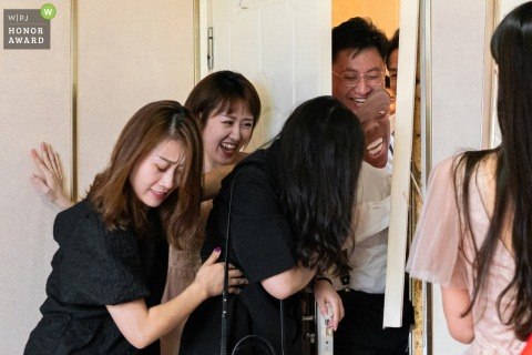 China wedding photo created as The bridegroom broke the doorframe when he broke the door to marry the bride