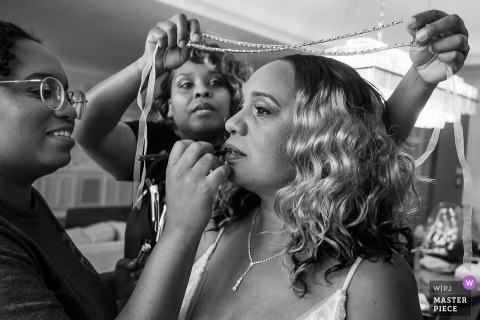 Bride gets help with makeup and jewelry at the Chateau Elan, Braselton, Georgia