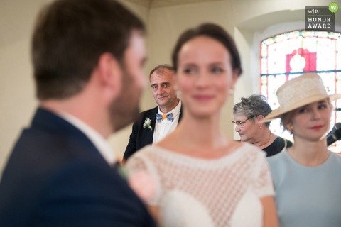 Wedding photo from Manoir de Corny France showing the brides father gaze