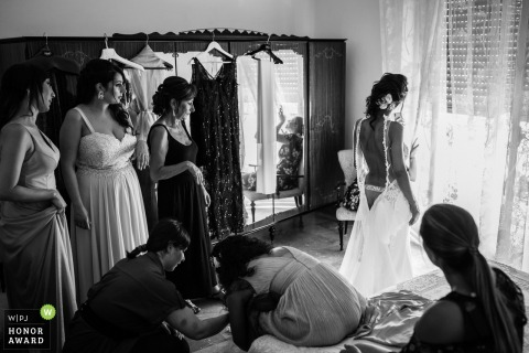 Wedding photo from the Castroreale, bride's Home created as The bride is waiting someone can help her