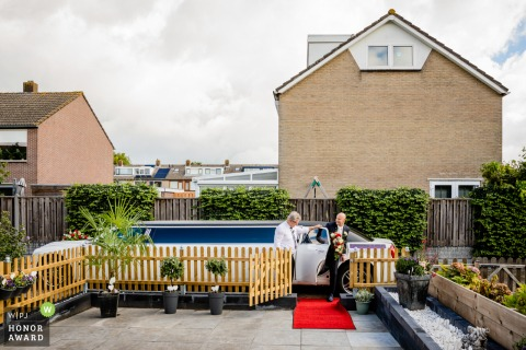 Zuid Holland outdoor wedding photo At home showing the arriving of the groom