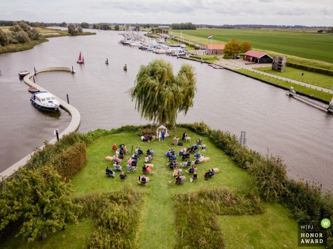 Zuid Holland drone wedding photo during ceremony showing social distancing during the event