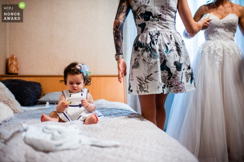 Bridal Home, Ruse, Bulgaria wedding image showing The little flower-girl is waiting while the Bride is getting ready