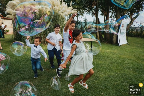 Image of Kids playing with bubbles at the Reception Venue of Casale Torre Sant'Anastasia