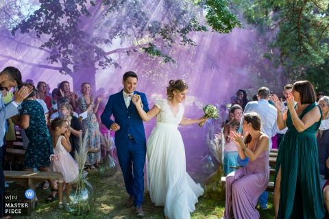 Auvergne-Rhône-Alpes Ceremony photography with amazing purple smoke outdoors
