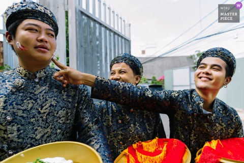 Ho Chi Minh Vietnam wedding photo of the groomsmen having fun outdoors