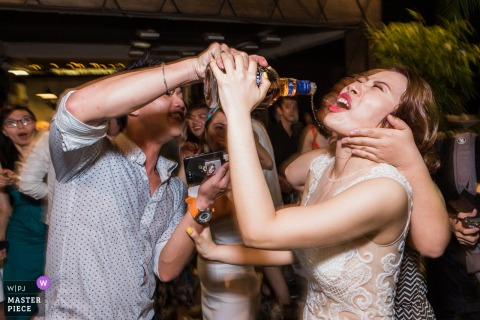 Image of the bride receiving unwanted drinks in Ho Chi Minh Vietnam at the club after party