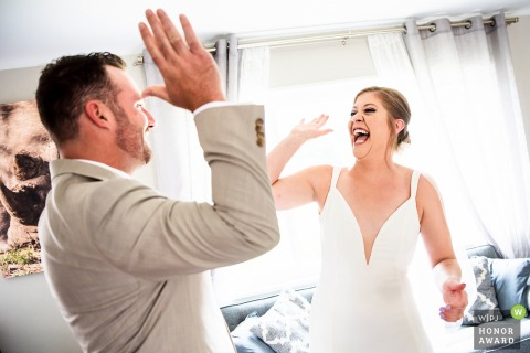 Northglenn, CO private residence wedding image of the Bride and groom high-fiving after first look