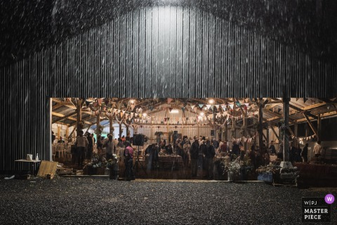 Carhaix, France Rain during the evening barn wedding indoor reception party