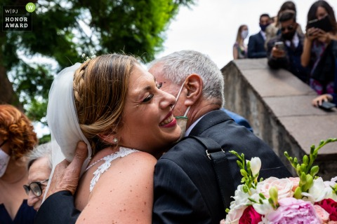 Palazzo Duchi di Santo Stefano, Taormina wedding photo of the The bride's embrace to her grandfather, revised after nine months due to the pandemic