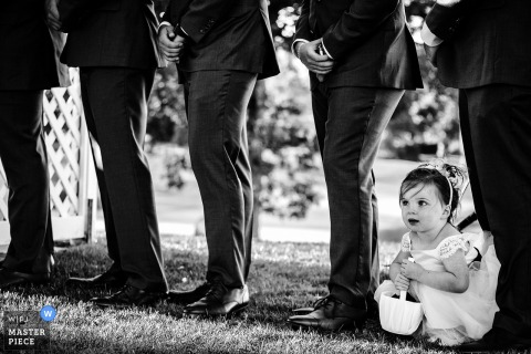 Image of the flower girl at the ceremony at cog hill country club