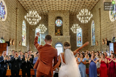 Igreja Matriz de Gramado wedding photo of the couple waving to their family and guests