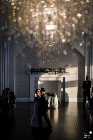 Belle Mer Wedding Reception photography of the bride and groom dancing in great light