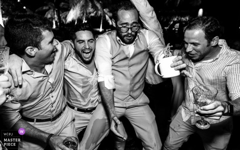 Wedding photography from a Brazil Reception party venue with guests drinking and jumping high