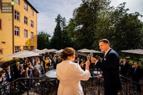 Germany wedding photography from the Schloss Hotel Gedern at The outdoor reception during bride and groom toasts