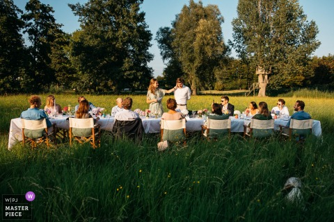 The bride is comforting her husband during her speech at this Belgium backyard wedding
