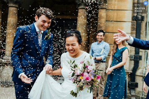 "Hertford College Chapel, Oxford University wedding photographer, ""Confetti outside the chapel. I got in really close with my 35mm for this shot to immerse myself in the moment"""