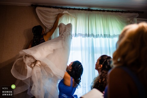 A Bulgarian bride is preparing to put on her dress at her parent's Ruse home