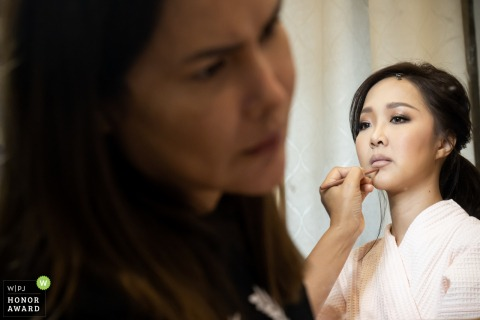 Indoor wedding photo from the Bride's house, Ubon Ratchathani of her Getting Ready with makeup