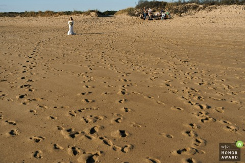 The Massachusetts bride approachs toward the ceremony at Herring Cove Beach in Provincetown